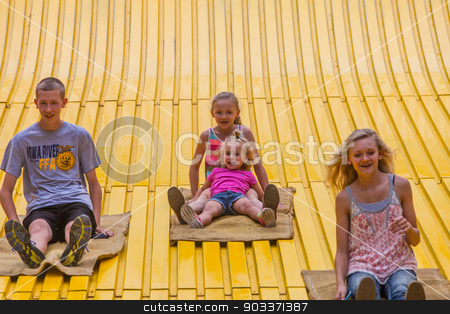 Kids on carnival slide at state fair stock photo, DES MOINES, IA /USA - AUGUST 10: Unidentified children on jumbo slide at the Iowa State Fair on August 10, 2014 in Des Moines, Iowa, USA. by Scott Griessel
