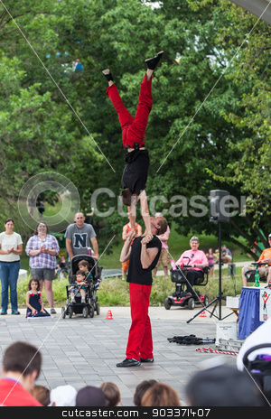 Acrobats at Iowa State Fair stock photo, DES MOINES, IA /USA - AUGUST 10: Red Trouser Show acrobats David Graham, below, and Tobin Renwick at the Iowa State Fair on August 10, 2014 in Des Moines, Iowa, USA. by Scott Griessel