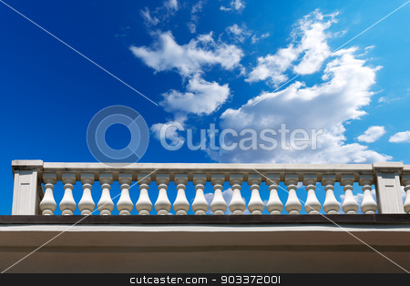 Balustrade Pillars on a Cloudy Sky stock photo, Old white stone balustrade with blue sky and clouds in the background by catalby