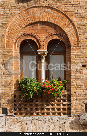 San Gimignano - Siena Tuscany Italy stock photo, Detail of a mullioned window on medieval brick wall in San Gimignano town (UNESCO heritage), Siena, Tuscany, Italy by catalby