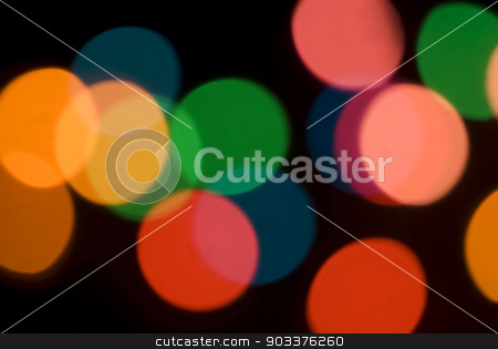 Bokeh of colorful party lights stock photo, Bokeh of colorful party lights in red, orange and green for a festive background for a celebration or holiday by Stephen Gibson
