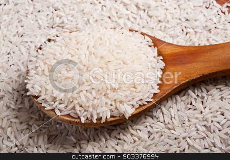 Rice and spoon. stock photo, Rice and old wooden spoon. by Pablo Caridad
