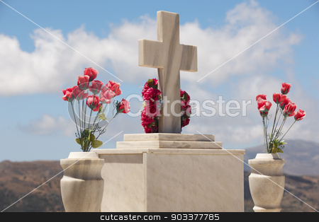 Marble tombstone in a cretan graveyard. Greek stock photo, Marble tombstone in a cretan graveyard. Greek. Horizontal by ABBPhoto