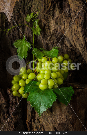 still life with green grape. stock photo, Still life with green grapes on the timber. by SONGSAK  AROMYIM