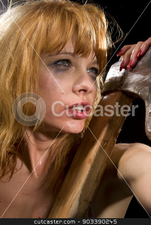 axe girl stock photo, dark bizarre portrait of wild redhead girl with axe by Syda Productions