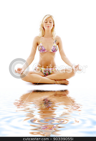 meditation on white sand #2 stock photo, meditating blonde in bikini on white sand by Syda Productions
