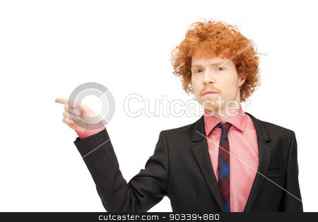 businessman pointing his finger stock photo, picture of attractive businessman pointing his finger by Syda Productions