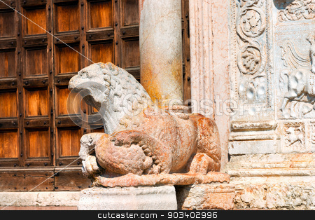 Basilica of San Zeno Verona - Marble Lion stock photo, Detail of the lion and column in red marble of the Basilica of San Zeno (X-XI century) in Verona Italy. Is considered one of the masterpieces of Romanesque architecture in Italy by catalby