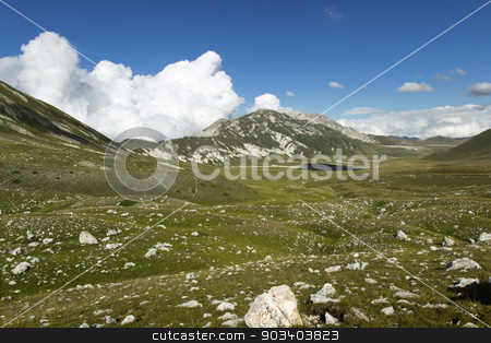 one stone stock photo, beautiful mountain view and blue cloudy sky by metrue
