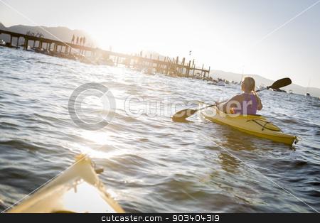 Woman Kayaking on Beautiful Mountain Lake. stock photo, Woman Kayaking on Beautiful Peaceful Mountain Lake at Sunset. by Andy Dean