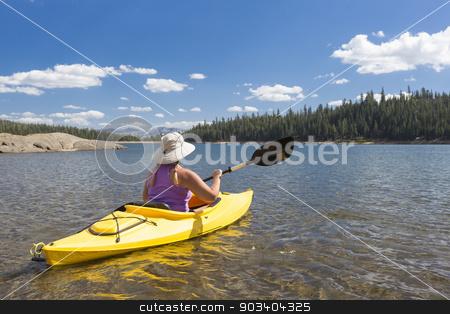 Woman Kayaking on Beautiful Mountain Lake. stock photo, Woman Kayaking on Beautiful Peaceful Mountain Lake. by Andy Dean