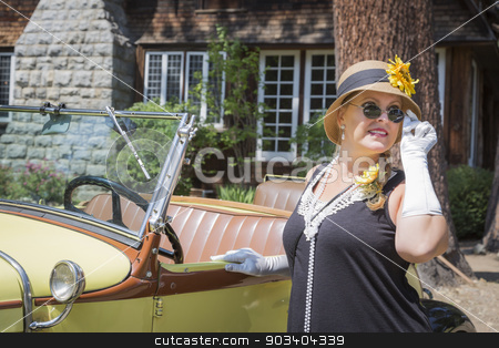 Attractive Woman in Twenties Outfit Near Antique Automobile stock photo, Attractive Young Woman in Twenties Outfit Near Antique Automobile. by Andy Dean