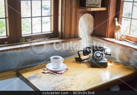 Antique Phone and Cup of Coffee in Old Kitchen Setting stock photo, Classic Antique Phone and Cup of Coffee in Old Kitchen Setting. by Andy Dean