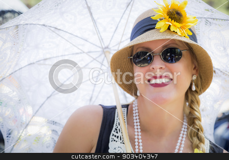 Attractive Woman in Twenties Outfit Holding Parasol stock photo, Young Attractive Woman in Twenties Outfit Holding Parasol. by Andy Dean