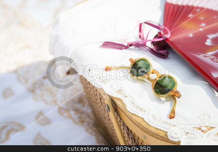 Sunglasses, Chinese Fan and Picnic Basket on Blanket stock photo, Stylish Sunglasses, Chinese Fan and Picnic Basket on Blanket. by Andy Dean