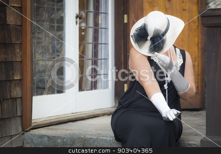 Attractive Woman in Twenties Outfit on Porch of Antique House stock photo, Attractive Young Woman in Twenties Outfit on Porch of an Antique House. by Andy Dean