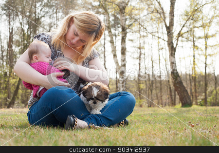 Mother is caring for her baby stock photo, Mother is having a trip with the baby and dog outside by Frenk and Danielle Kaufmann