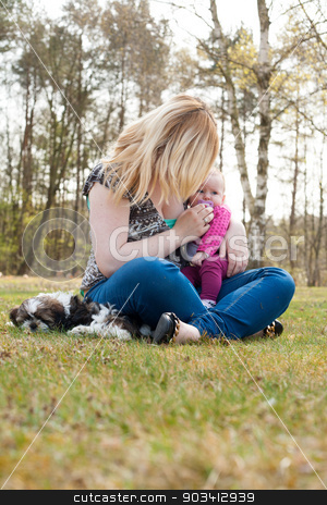 unrecognizable mother stock photo, Mother is having a trip with the baby and dog outside by Frenk and Danielle Kaufmann