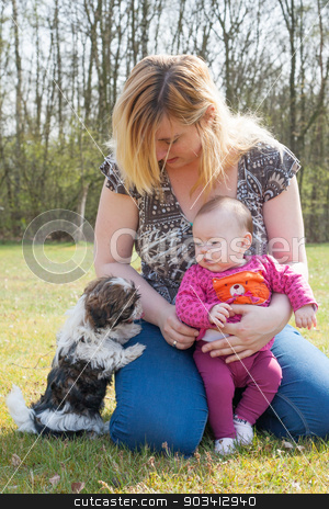 Mother her baby and puppy stock photo, Mother is having a trip with the baby and dog outside by Frenk and Danielle Kaufmann
