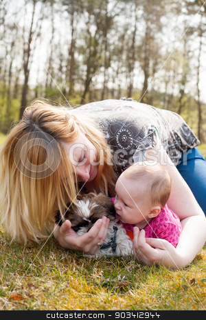 Mother is playing with puppy and baby stock photo, Mother is having a trip with the baby and dog outside by Frenk and Danielle Kaufmann