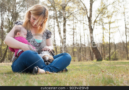 mother with puppy and baby on the grass stock photo, Mother is having a trip with the baby and dog outside by Frenk and Danielle Kaufmann