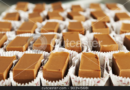Chocolate sweet blocks stock photo, Block of chocolate sweets on a tray into their decorate wrapping by Dario Rota