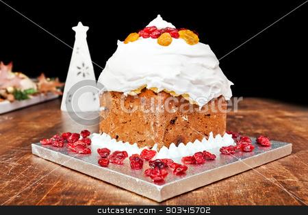 Christmas cake and white candle stock photo, Christmas cake with red candieds and white candel  by Dario Rota