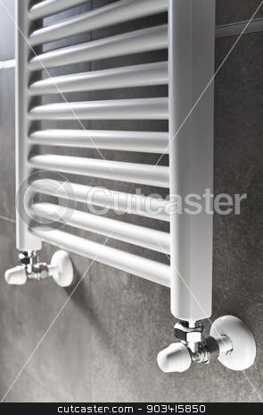 Bathroom heater perspective stock photo, White bathroom heater closeup on gray wall  by Dario Rota