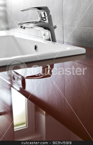 Faucet reflection stock photo, Bathroom faucet closeup with riflection on the red translucent board  by Dario Rota