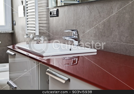 Red bathroom faucet reflection stock photo, Red bathroom with toilette, bidet, heater, lavabo and mirror  by Dario Rota