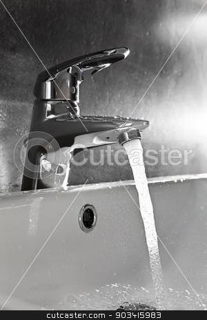 Sink closeup splash backlight stock photo, Bathroom sink silhouette lighted by backlight with water splash by Dario Rota