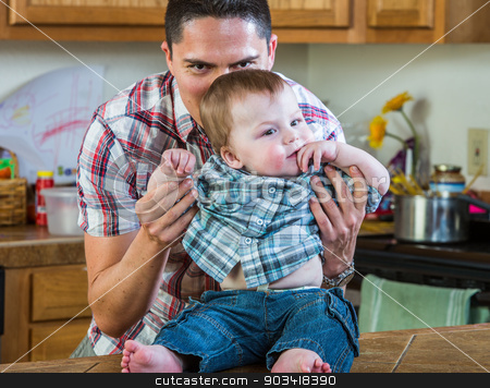 Father Plays With Baby stock photo, A father in kitchen plays with his baby by Scott Griessel