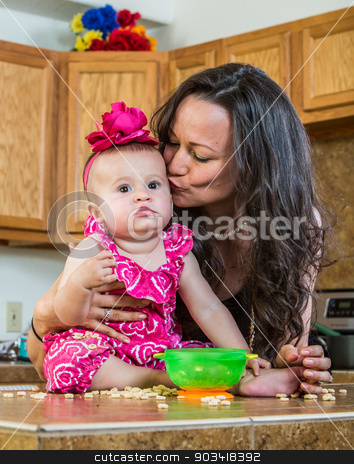 Mother Kisses Her Baby stock photo, Mother in kitchen kisses her baby by Scott Griessel