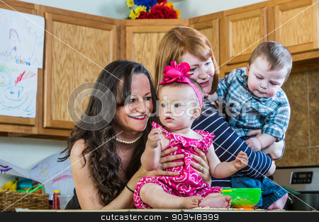 Mothers Play With Their Babies stock photo, Mothers in kitchen play with their babies by Scott Griessel