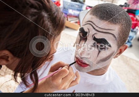 Circus Clown Makeup stock photo, Makeup artist lining lips of male circus clown by Scott Griessel