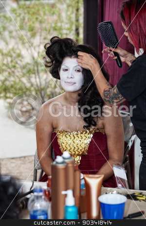 Makeup Artist Working on Cirque Performer stock photo, Makeup artist working on beautiful young circus clown by Scott Griessel