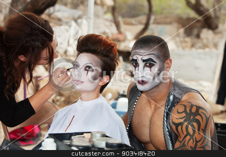 Clowns Getting Makeup stock photo, Makeup artist working clown eyeliner for performers by Scott Griessel