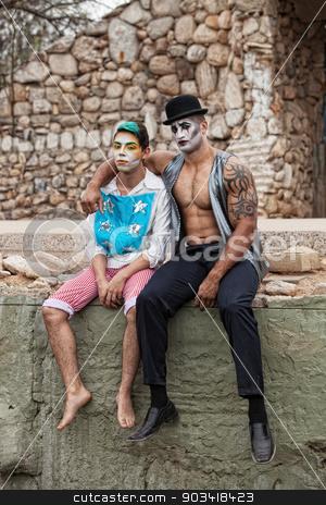 Comedia Del Art Men stock photo, Handsome comedia del arte male performers sitting outside by Scott Griessel