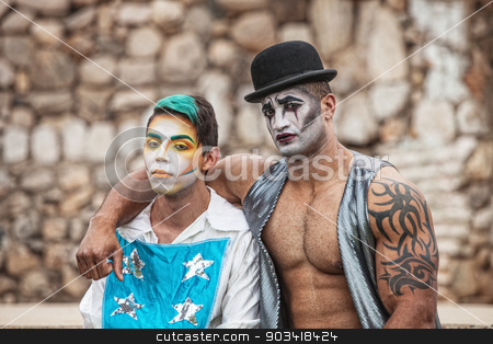 Two Male Cirque Performers stock photo, Pair of handsome male cirque performers outside by Scott Griessel