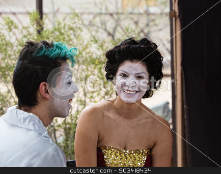 Laughing Circue Performers stock photo, Two cirque performers in makeup laughing backstage by Scott Griessel