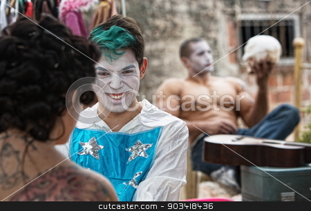 Cirque Clowns Giggling stock photo, Giggling male cirque clown laughing with friend backstage by Scott Griessel