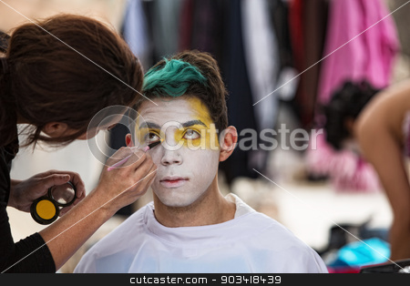 Makeup Artist Paining Clown Face stock photo, Make up artist painting face of young clown by Scott Griessel