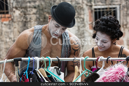 Cirque Clown stock photo, Two cirque clowns choosing costumes at clothing rack by Scott Griessel