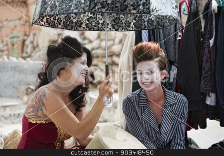 Cute Clowns Backstage with Umbrella stock photo, Two female cirque clowns with umbrella outdoors by Scott Griessel