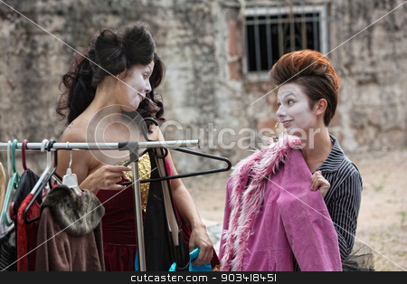 Female Actors Fitting Coat stock photo, Beautiful female actors in white makeup fitting pink coat by Scott Griessel