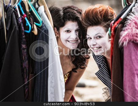 Clowns Peeking from Clothes Rack stock photo, Pair of young cirque clowns peeking from clothing rack by Scott Griessel