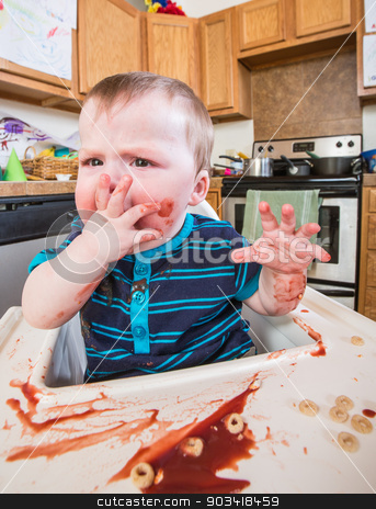 Grumpy Child Eats stock photo, A grumpy child eats breakfast in the kitchen by Scott Griessel