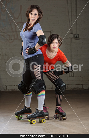 Female Roller Derby Skaters stock photo, Pair of tough Caucasian female roller derby skaters by Scott Griessel