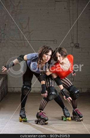 Female Roller Derby Skaters Posing stock photo, Pair of beautiful female roller derby skaters in action pose by Scott Griessel