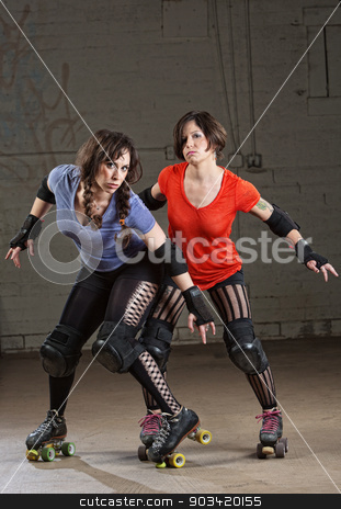 Serious Roller Derby Skaters stock photo, Two pretty women in roller derby outfit by Scott Griessel